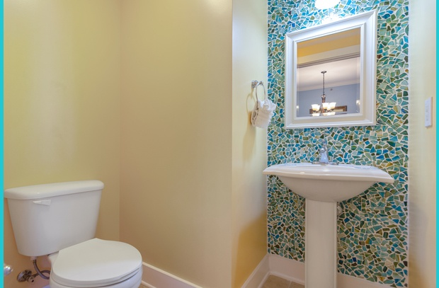 Wow! Check out the distinctive glass-chipped wall tile in the guest bathroom