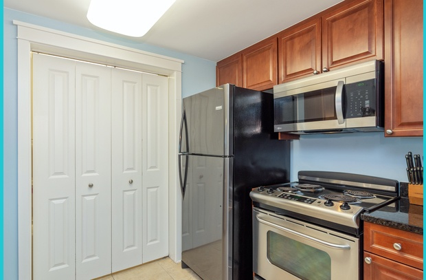 Conveniently stocked kitchen with granite and stainless appliances