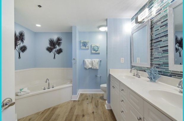 Spacious master bathroom with garden tub, full shower and double vanity